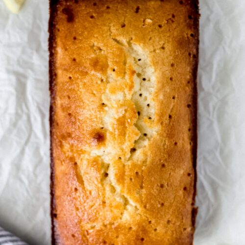 overhead view glazed lemon bread with knife and napkin