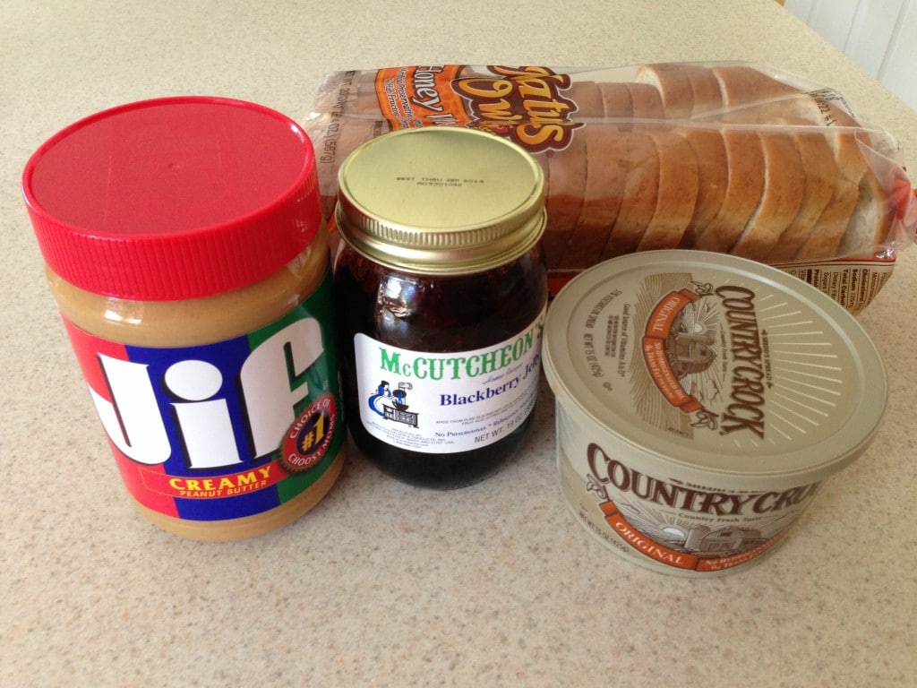 close-up side view of ingredients for grilled peanut butter and jelly sandwich