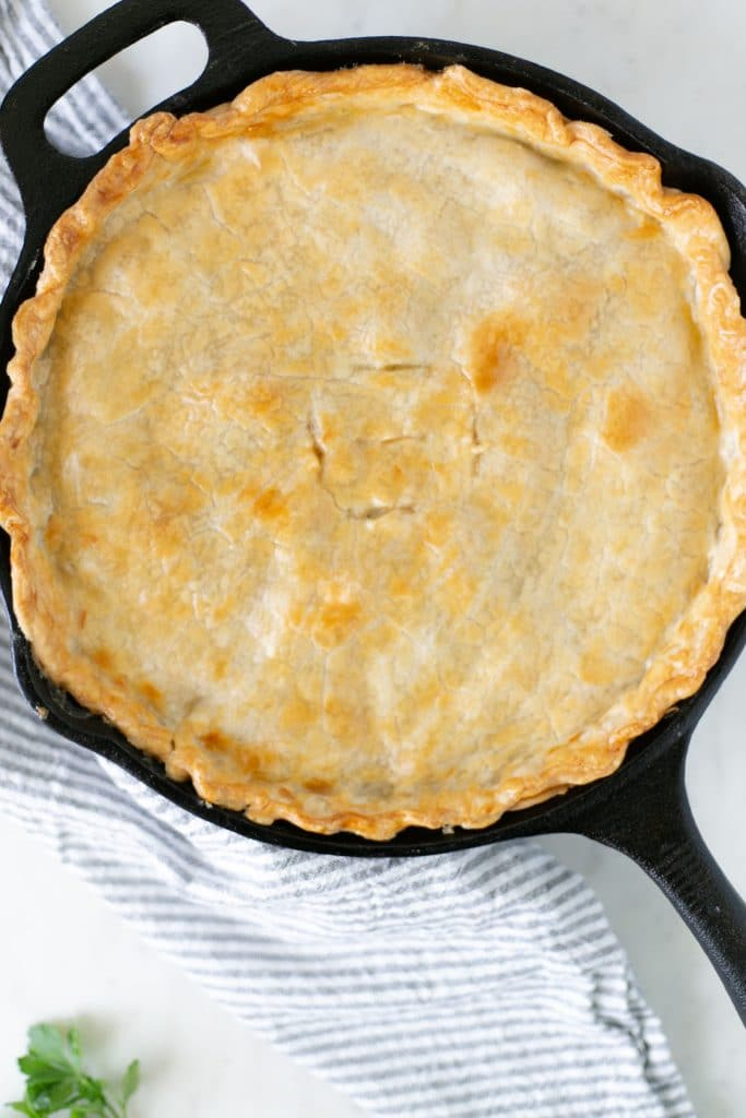 Overhead view Easy Chicken Pot Pie in cast iron skillet