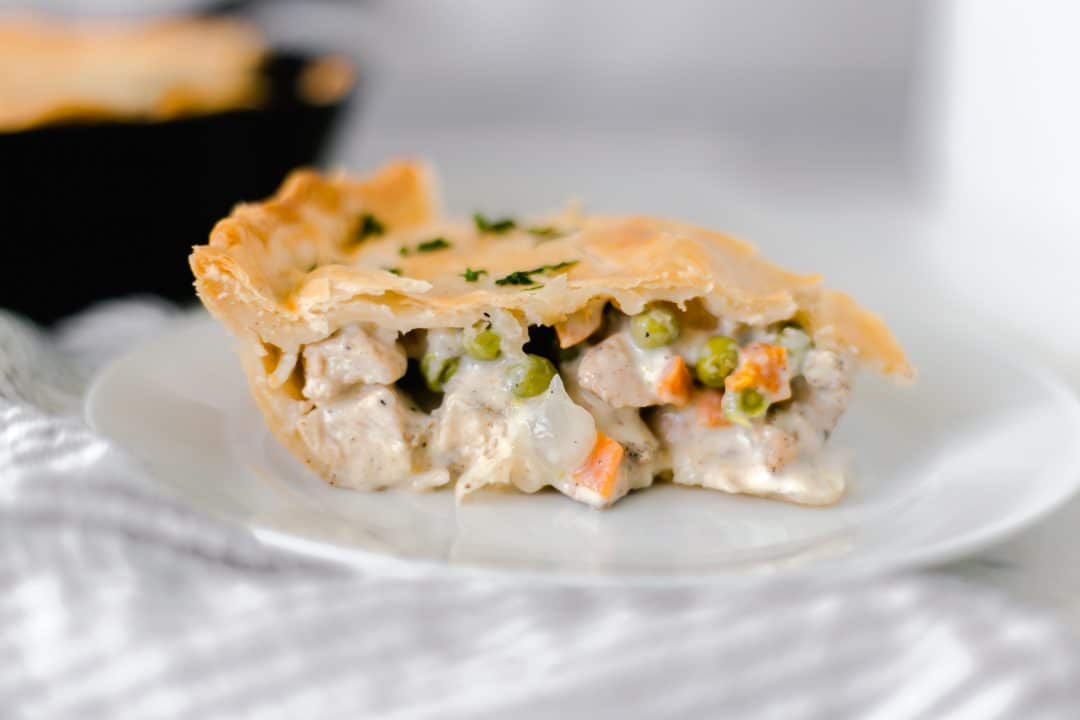 close-up side view chicken pot pie on plate