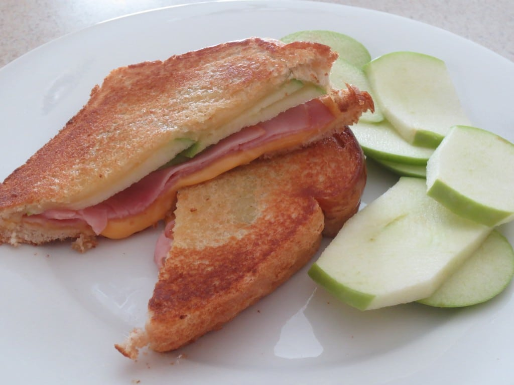 It is National Grilled Cheese Day! A great way to celebrate is with a sandwich with ham, cheese, and sliced apple. So many flavors packed in one sandwich. #sandwich #grilledcheese