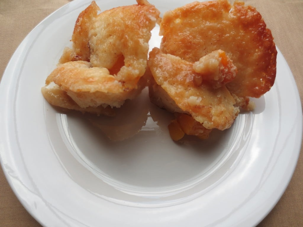 close-up view of two mini peach cobbler on plate