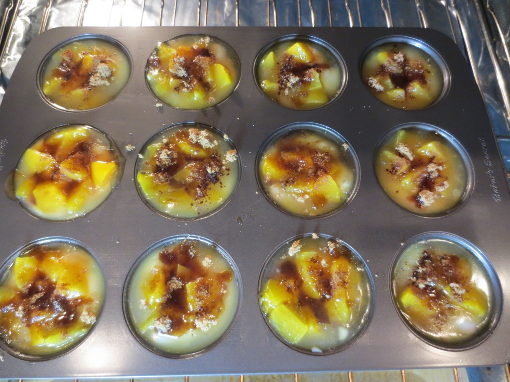 mini peach cobbler placed in oven before baking