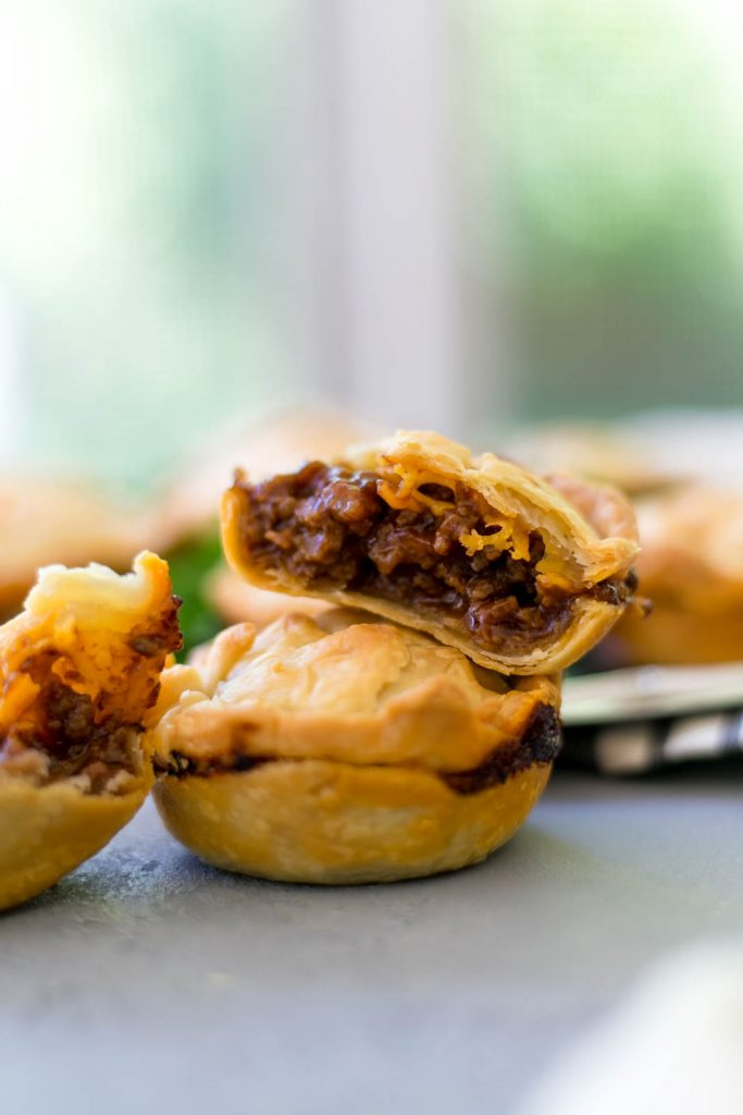Mini BBQ Beef Pies are the perfect quick and easy dinner that the whole family will love. Tasty beef, cheese, sauce, wrapped in pie crust is so delicious. simplylakita.com