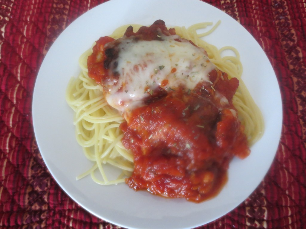 Easy Skillet Chicken Parmesan is a quick dinner that has tender breaded chicken fried and topped with a sauce and creamy Parmesan cheese. The perfect dinner. simplylakita.com #dinner #chicken