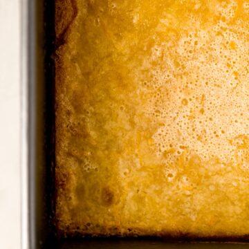 close up view of lemon bars in baking dish