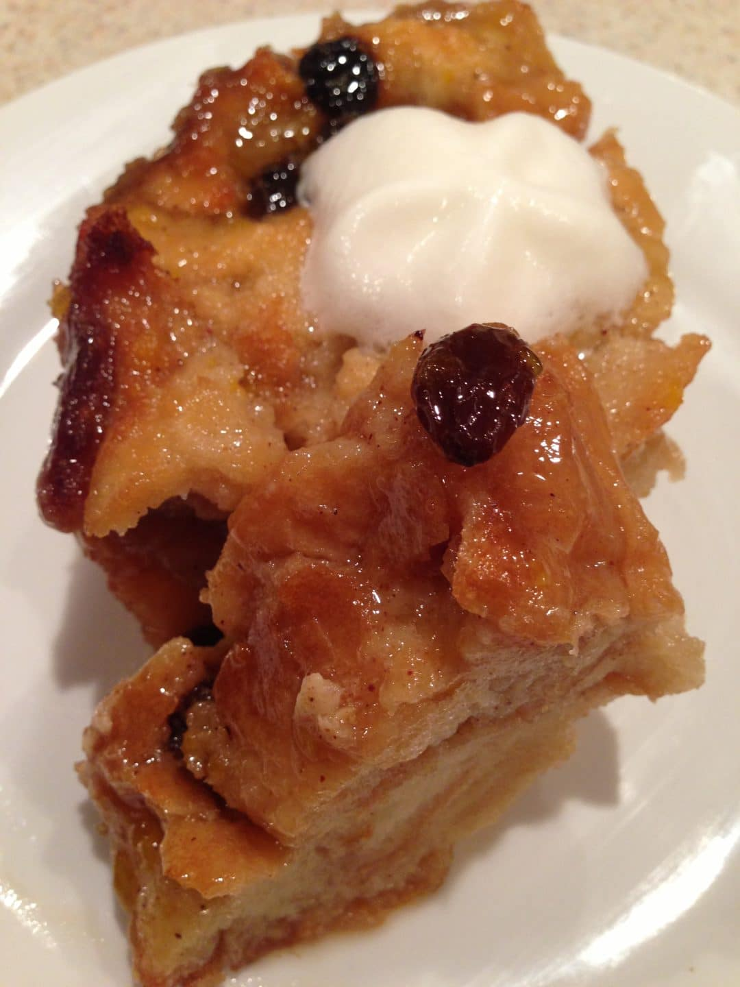 Bread Pudding with Brown Sugar Sauce is a sweet and delicious treat that is perfect when made with crusty bread and few ingredients. Topped with a brown sugar sauce that makes it extra tasty. simplylakita.com #breadpudding #dessert
