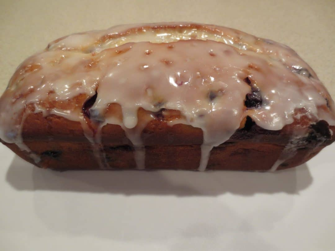 Lemon Blueberry Bread is a sweet and tangy bread that is topped with a delicious sweet glaze that makes this treat perfect when paired with a cup of coffee. simplylakita.com #lemon #blueberry #bread