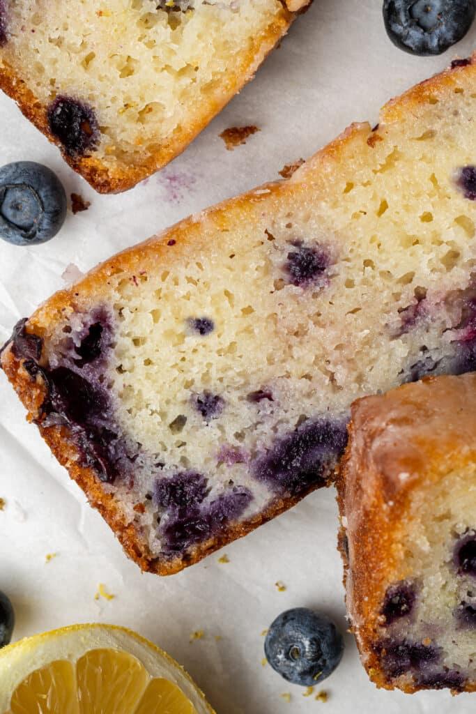 slices on lemon blueberry bread on parchment paper
