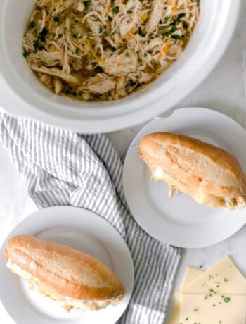 Philly Cheese Chicken Sandwich is cooked in a slow cooker and is the perfect recipe to feed a hungry family on the go. Meaty, Cheesy, and Delicious! simplylakita.com #chicken #easyrecipe #slowcooker #crockpot #instantpot