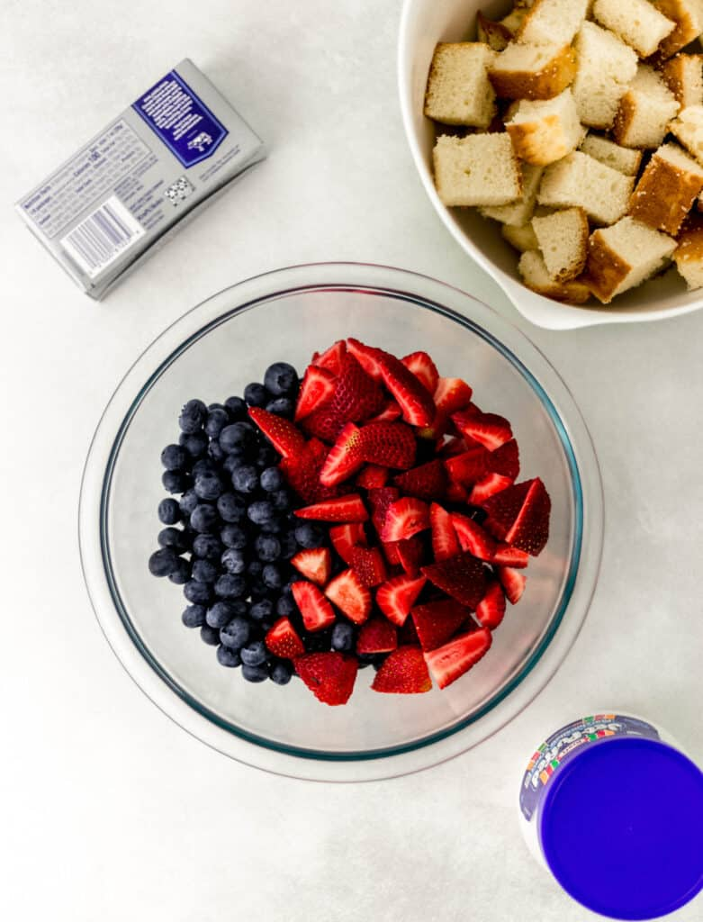 ingredients needed to make berry trifle in separate containers.