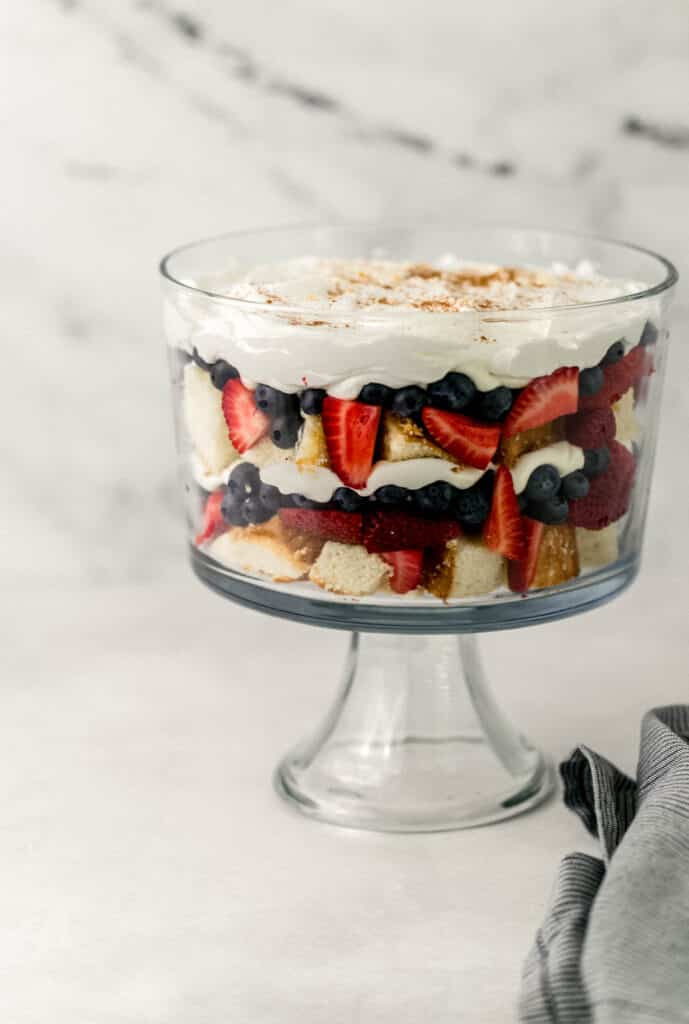 close up side view of trifle next to cloth napkin