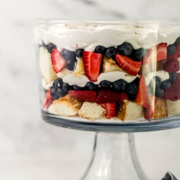 side view berry trifle in glass bowl