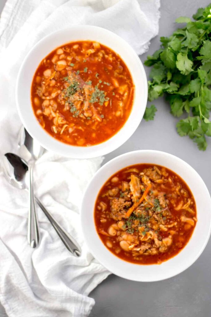 Italian Sausage and Bean Soup - Quick and easy one-pot soup that cooks up in less than 20 minutes. Hearty and comforting for the whole family to enjoy! simplylakita.com #soup #easyrecipe #sausage