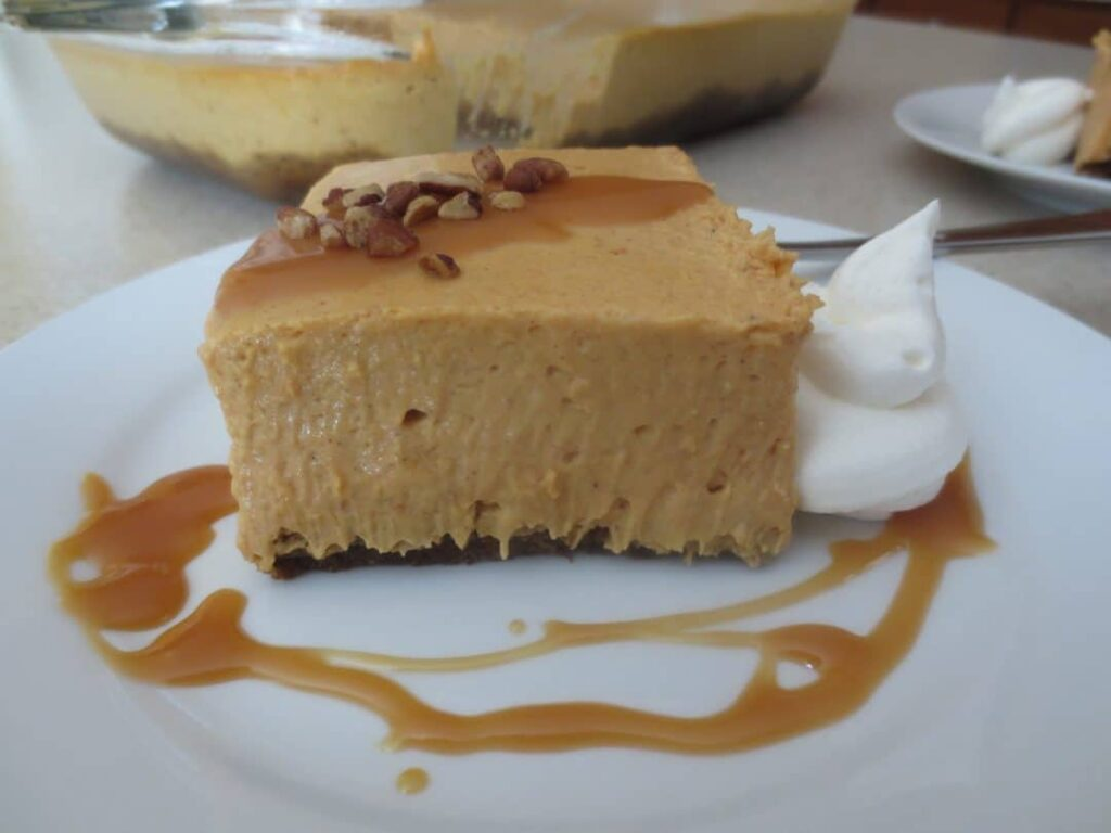 Pumpkin Cheesecake is rich, creamy, and made in a rectangle pan. Perfect for the holiday or the Fall to share with friends and family. simplylakita.com #pumpkin #fall #dessert