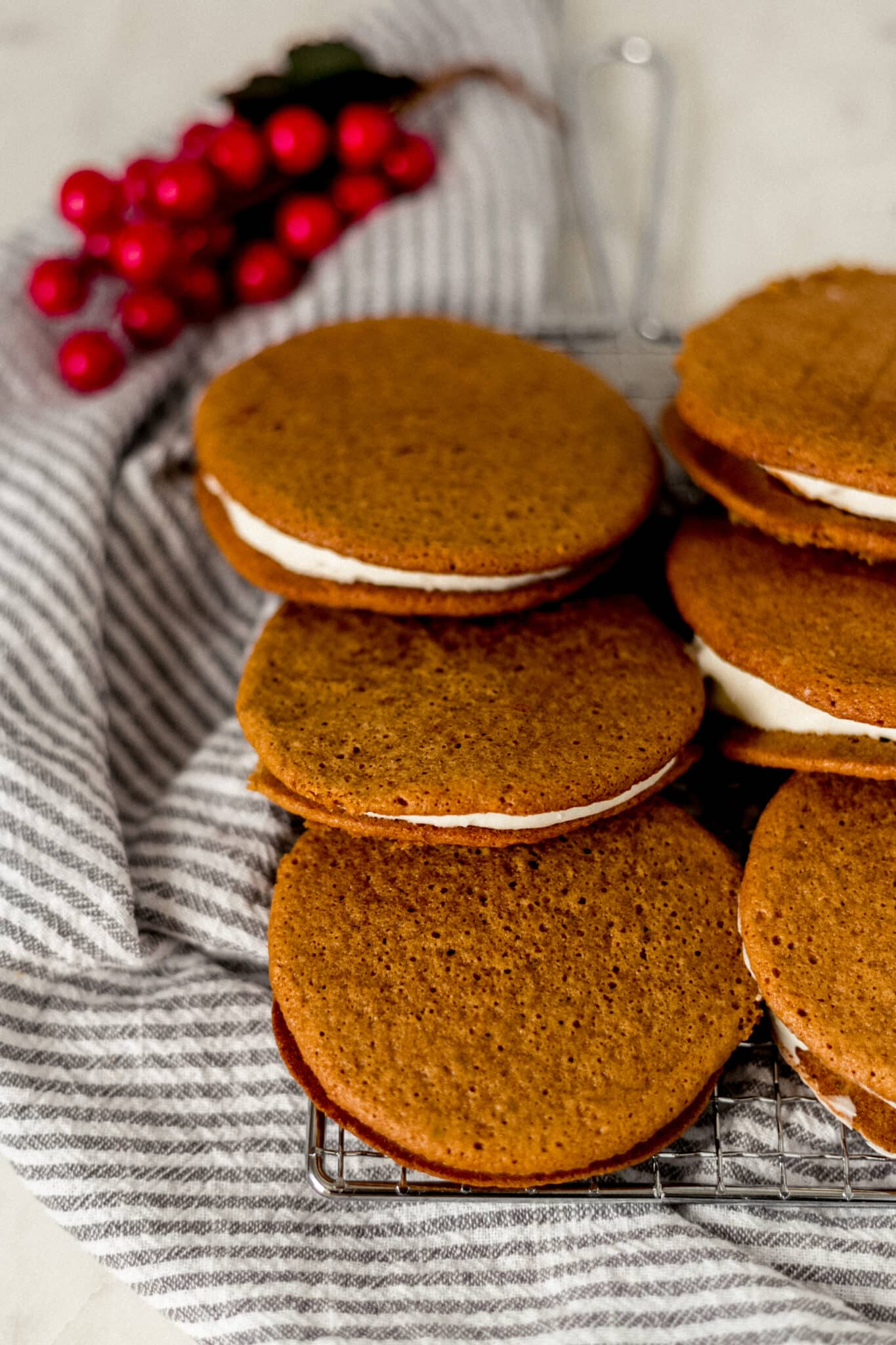 gingerbread whoopie pies on cooling rack with napkin
