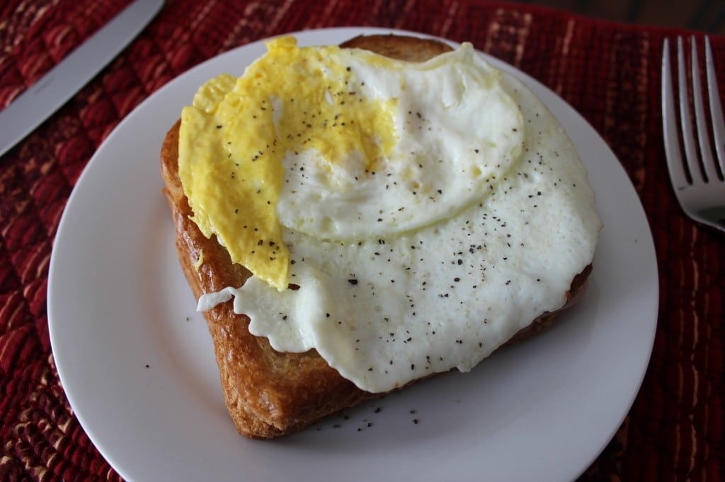 Croque Madame is a tasty breakfast or brunch sandwich that is made with buttery toast, ham, cheese, egg, and a tangy sauce. So many flavors are packed in one crispy sandwich. simplylakita.com