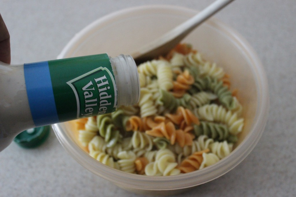 Ranch dressing being added to cooked Pasta