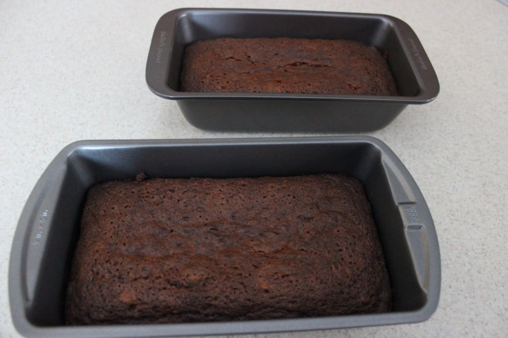 freshly cooked carrot bread resting in loaf pans