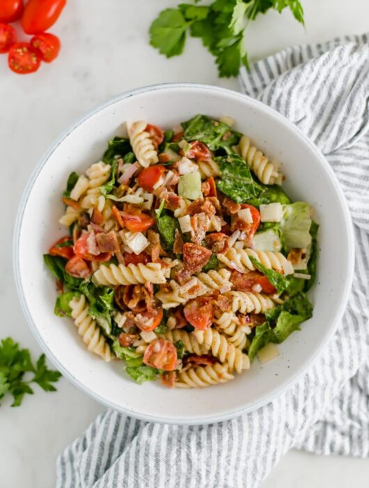 Ranch BLT Pasta Salad - This pasta salad recipe is loaded with delicious ingredients and includes a creamy dressing and chopped bacon. simplylakita.com #pastasalad #blt #salad #bacon