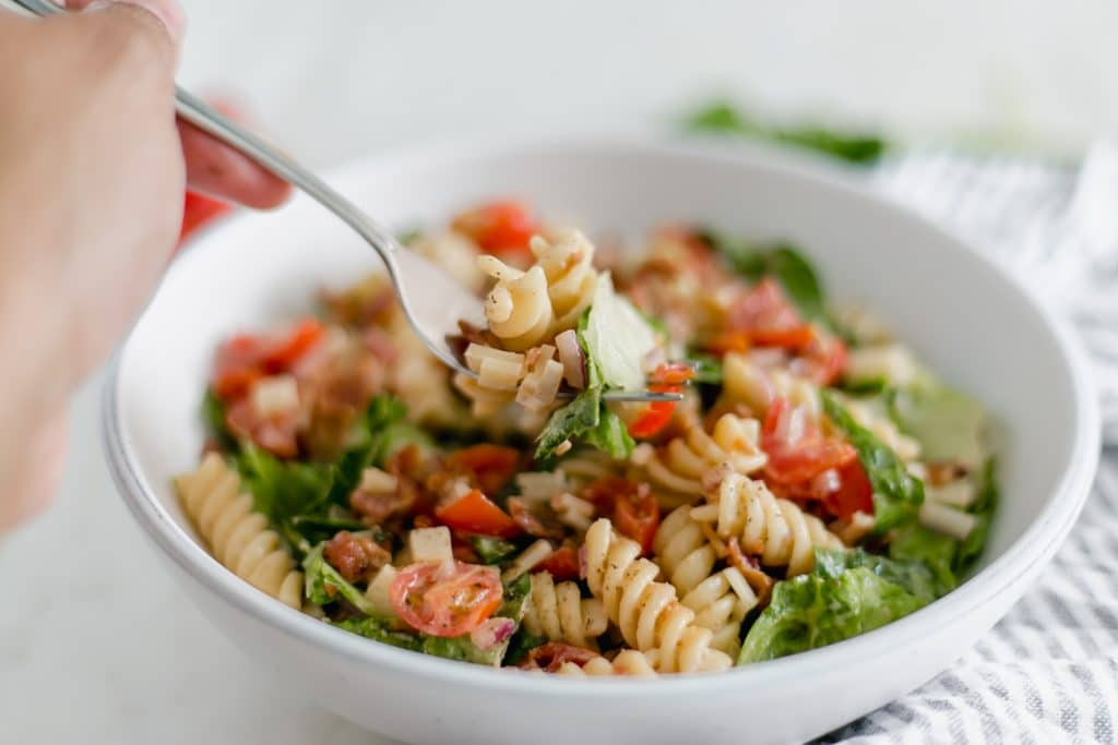 fork with bowl of ranch blt pasta salad