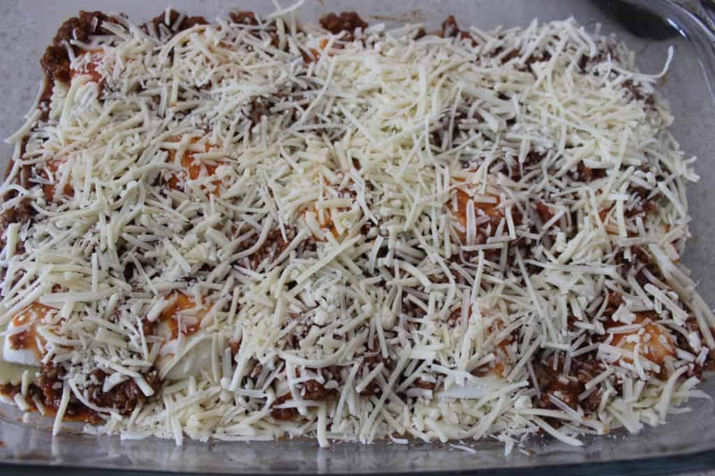the layering process of making ravioli lasagna