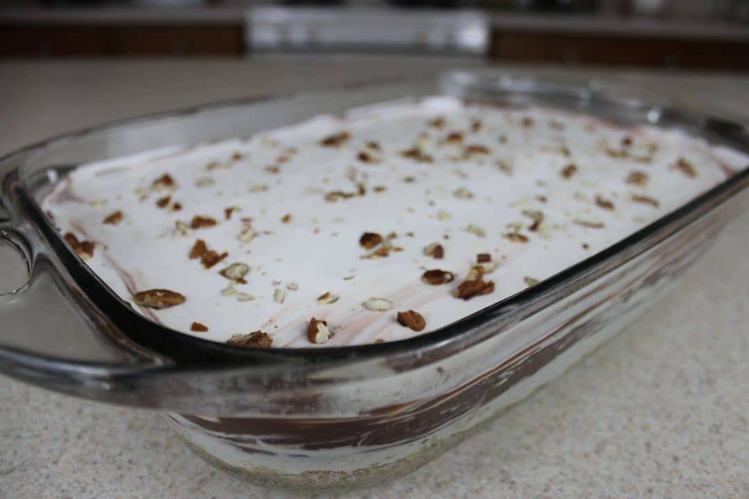 Chocolate Delight is a sweet, creamy, layered treat that is easy to make and the perfect dessert to make and share. Try making this treat for your next potluck. simplylakita.com