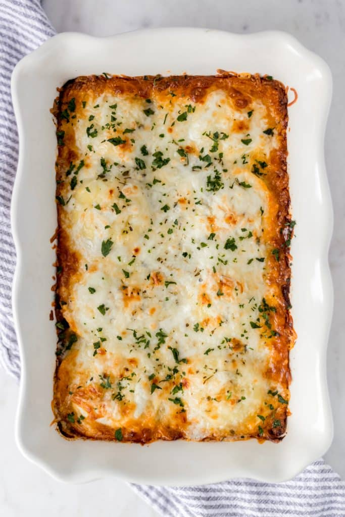 Ravioli Lasagna is the perfect busy night meal that only requires 5 ingredients and contains meat sauce, cheese ravioli, and other cheeses. Easy and tasty! simplylakita.com #lasagna #ravioli