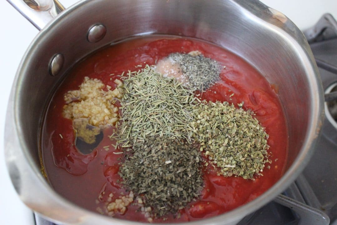 ingredients for easy homemade pasta sauce in a saucepan