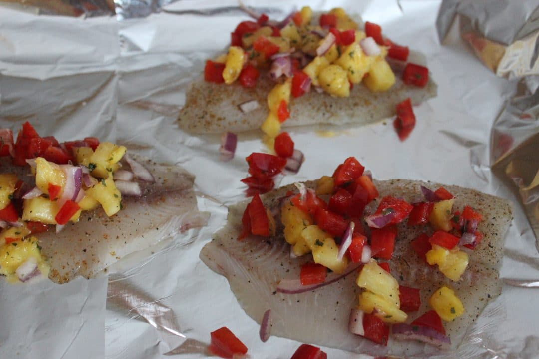 Steamed Tilapia with Pineapple Salsa is a simple dinner solution for those times when you are short on time and need a meal in a hurry. Spicy, sweet, tangy, and full of flavor. simplylakita.com
