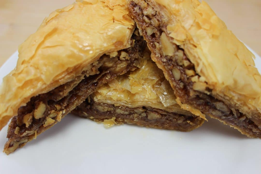 Baklava is a sweet, gooey, and rich dessert pastry that contain layers of filo dough, nuts, and sweetness for a delicious treat that can be made at home. simplylakita.com