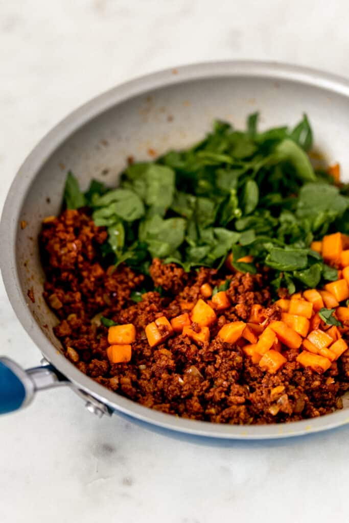 sweet potato, spinach, and chorizo in skillet