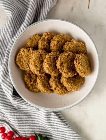 Bowl with a batch of no bake eggnog cookies over a napkin