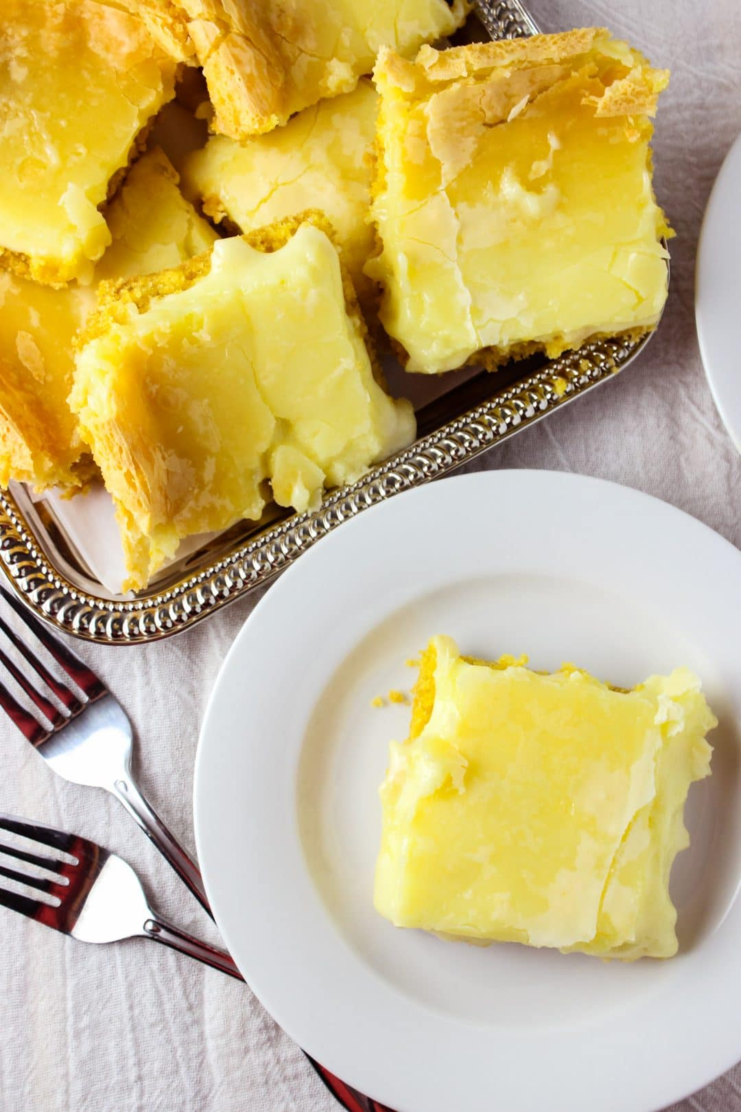 Easy Chess Squares - A Southern Staple made using only 5 simple ingredients which are cake mix, cream cheese, butter, eggs, and sugar. This recipe creates a dessert that is so Good and Sweet that you must give it a try! simplylakita.com #dessert