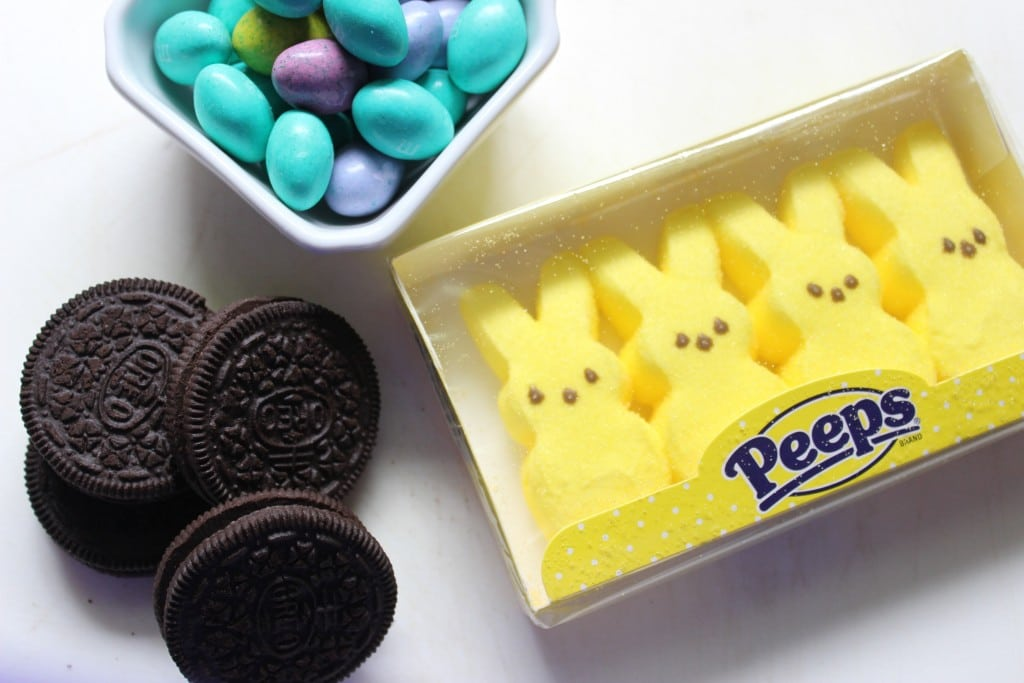 ingredients of oreo cookies, yellow marshmallow peeps, and candy