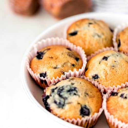 close up side view blueberry muffins in a bowl