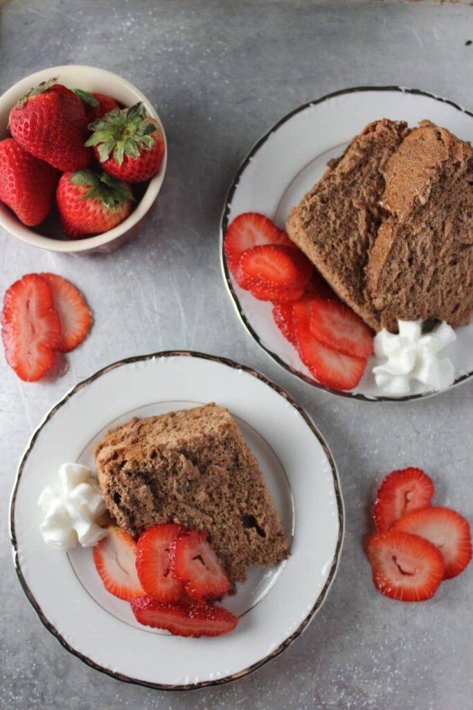 Chocolate Angel Food Cake with Strawberries is a healthier option that is light, fluffy, and loaded with the chocolate flavor. Pair with a side of strawberries for an extra layer of flavor. simplylakita.com #chocolate #cake