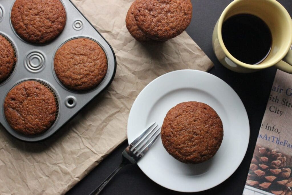 Gingerbread Muffins - A simple recipe that is wonderful to share during the holidays with warming spicy flavor in a fluffy delicious muffin. simplylakita.com #muffin #gingerbread