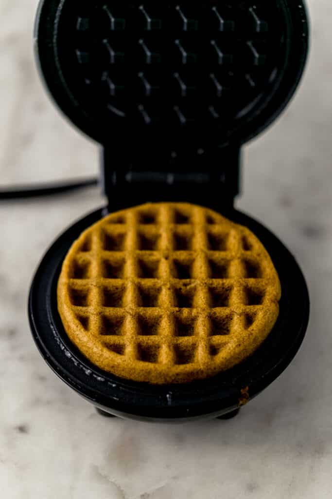 waffle maker with finished waffle in it.