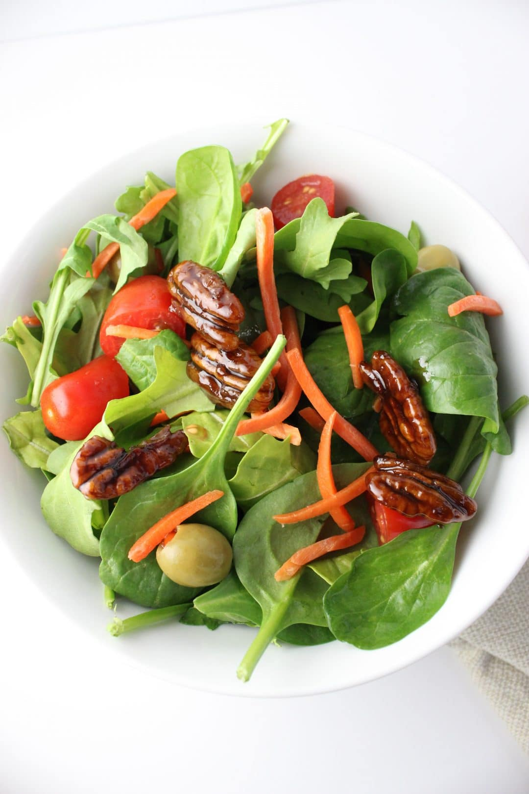 Coconut Sugar Candied Pecans on a Salad