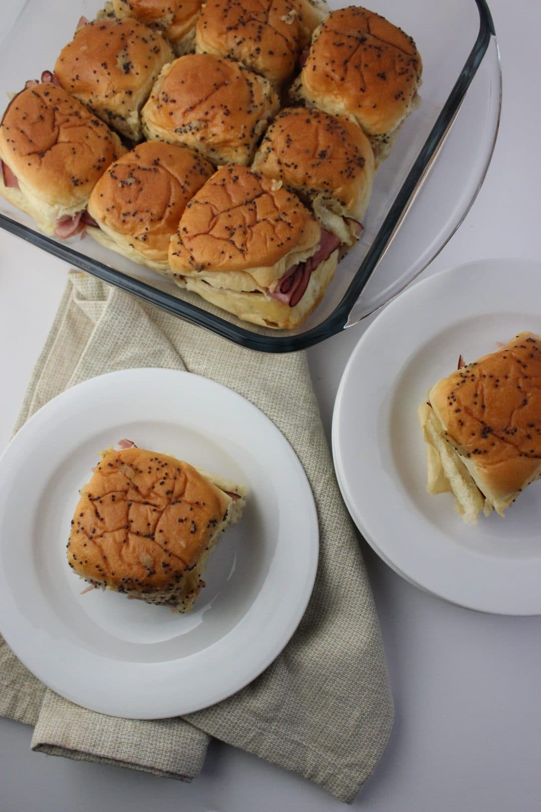 Hot Ham and Swiss Rolls - Easy and delicious recipe that is perfect for when you need a meal in minutes. Also topped with a sauce that is quick to make. simplylakita.com