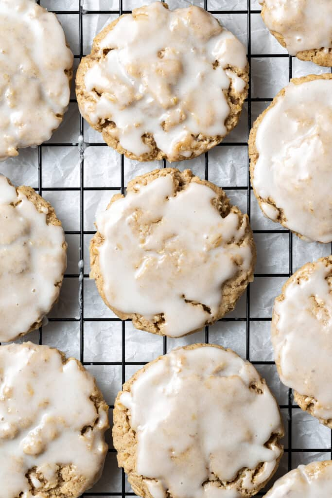 finished iced oatmeal cookies on baking rack