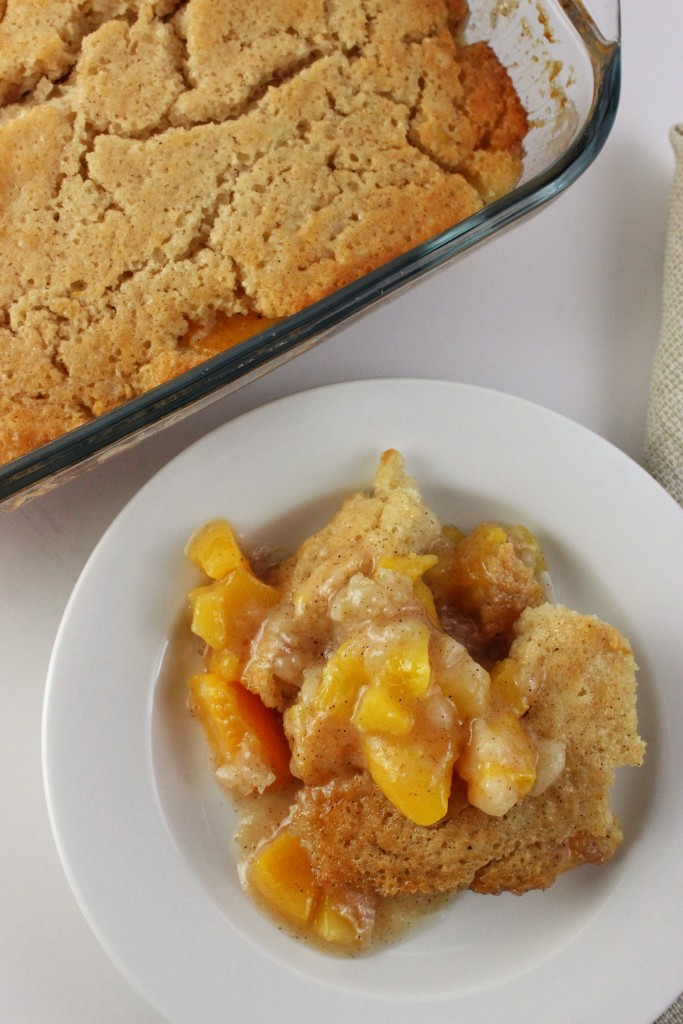 Easy Peach Cobbler - Our favorite easy dessert recipe that can be prepared in minutes and uses minimal ingredients. A super delicious fruity treat. simplylakita.com #peachcobbler #dessert