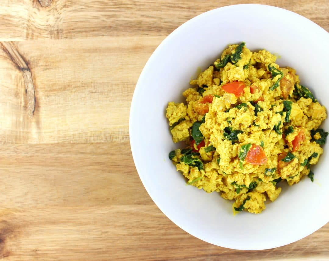 Tofu Scramble - Simply recipe made with baby spinach, diced tomatoes, and sauteed onions. Very quick and easy to make in under 30 minutes. simplylakita.com #vegan #tofu