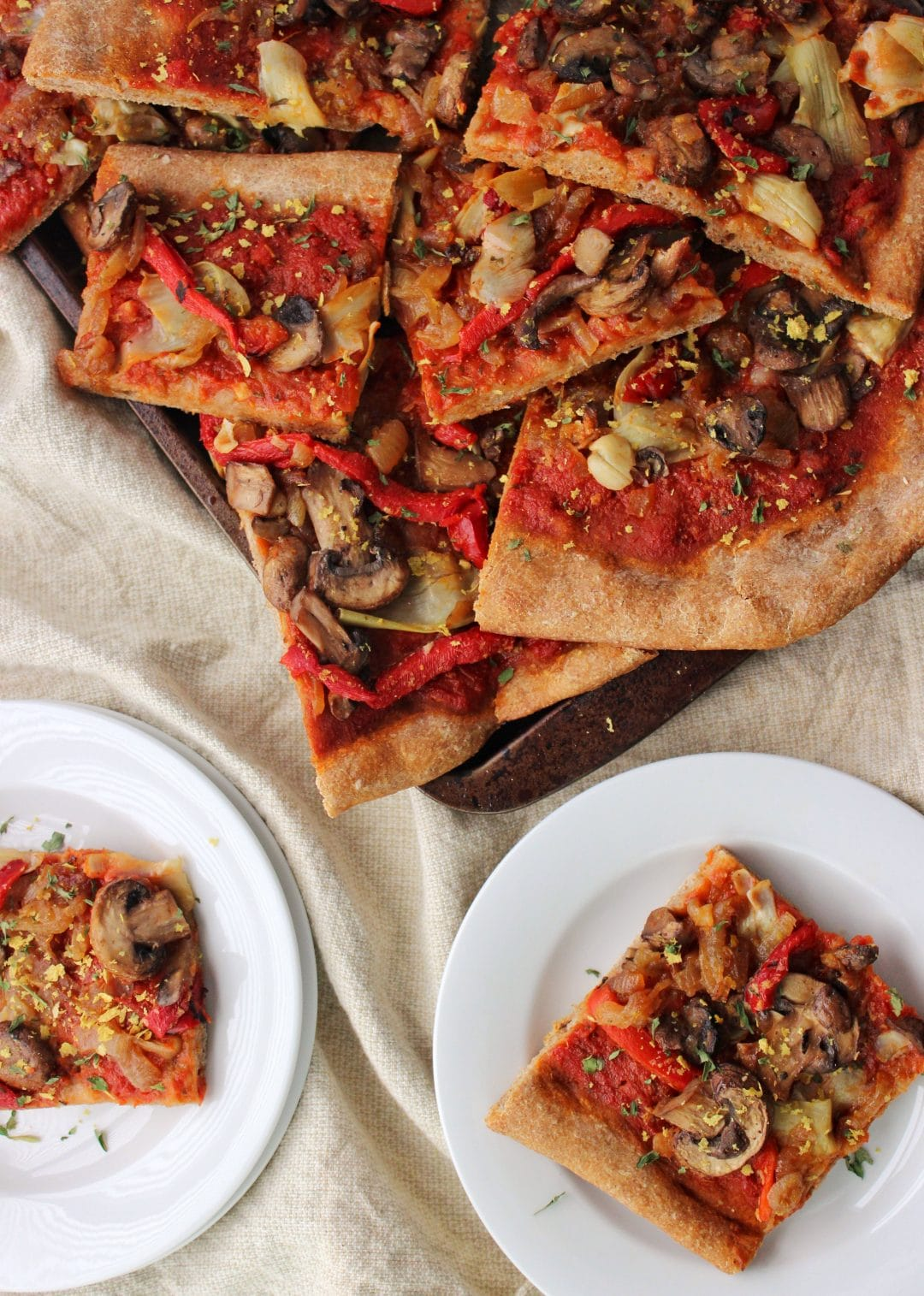 Quick Vegan Pizza - A delicious pizza recipe that anyone is sure to enjoy. Dairy free, loaded with veggies, and a pre-made crust. simplylakita.com #vegan #pizza
