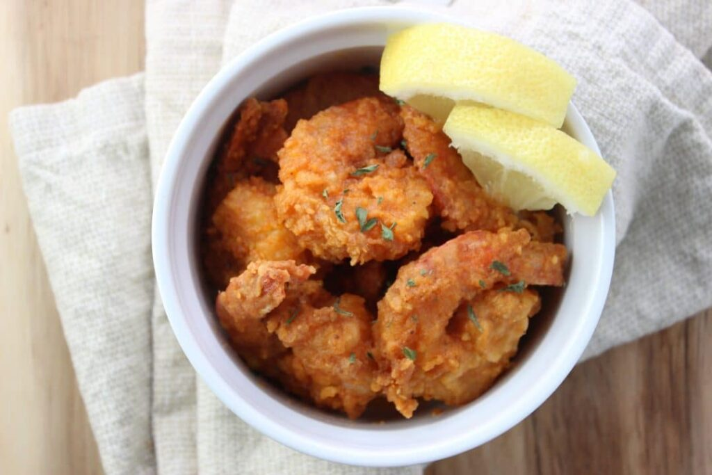 Easy Buffalo Shrimp Recipe - This recipe makes a fast and easy dish that is sure to be loved by everyone. Includes a homemade buffalo sauce. simplylakita.com #shrimp #buffalo