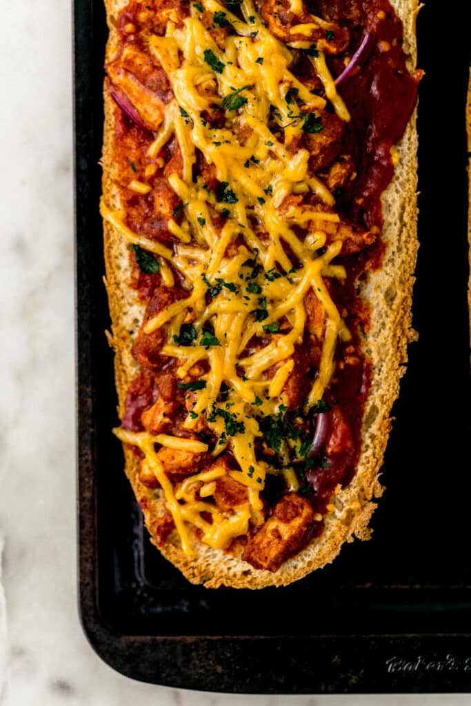 BBQ French bread pizza on baking sheet after baking and before serving.