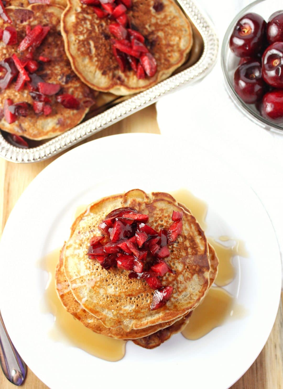 Vegan Cherry Pancakes - These pancakes are easy to make and are the perfect recipe to use when fresh cherries are in season. simplylakita.com #cherry #pancakes #vegan