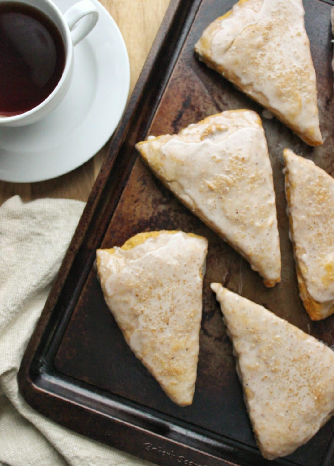 Pumpkin Scones - This easy recipe is perfect for the beginning of the Fall season and is full of flavor, made with spices and pumpkin puree. simplylakita.com #pumpkin #scones