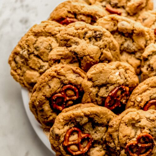 full white plate of chocolate chip pretzel cookies